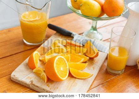 sliced oranges on a wooden cutting board. Healthy and tasty breakfast.