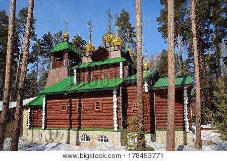 Wooden Russian Orthodox Christian Church of St. Sergius of Radonezh in Ganina Yama Monastery on early Spring, Yekaterinburg, Russia.