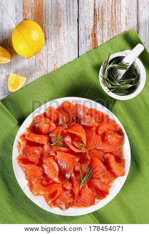 Slices Of Salted Red Fish On White Plate