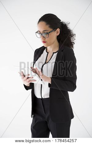 Young businesswoman working with a tablet on white background