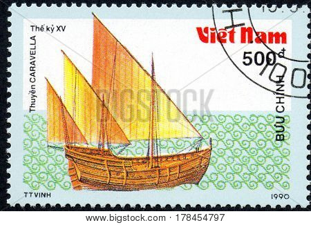 UKRAINE - CIRCA 2017: A postage stamp printed in Vietnam shows old sailing ship Caravella series Ancient boats 500d circa 1990