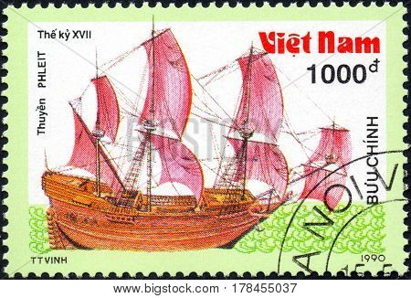 UKRAINE - CIRCA 2017: A postage stamp printed in Vietnam shows old sailing ship Flute series Ancient boats 1000d circa 1990