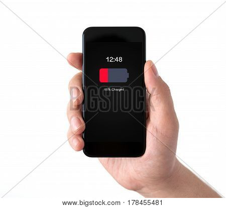 Isolated male hand holding black phone with low charged battery on screen