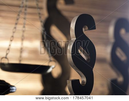 Law and justice concept - scale and legal code paragraph symbol on wooden background