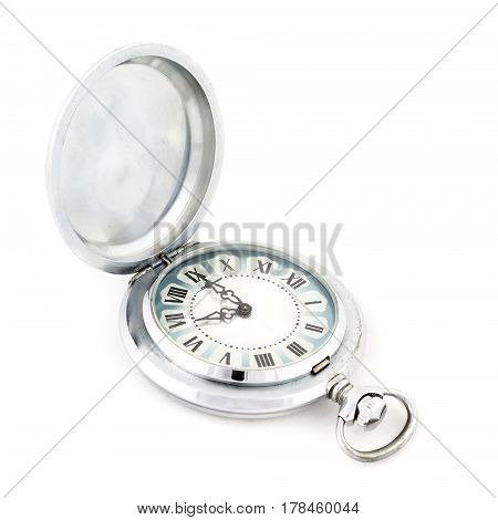 Old vintage scratched pocket silver watch on white background