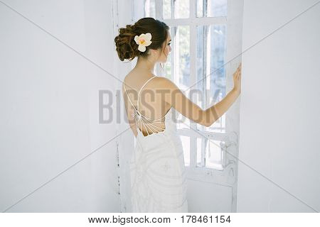 beautiful young girl in long dress. Fashion art photo. Flower in hair