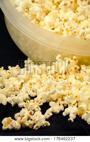 A close up of popped popcorn in a bowl