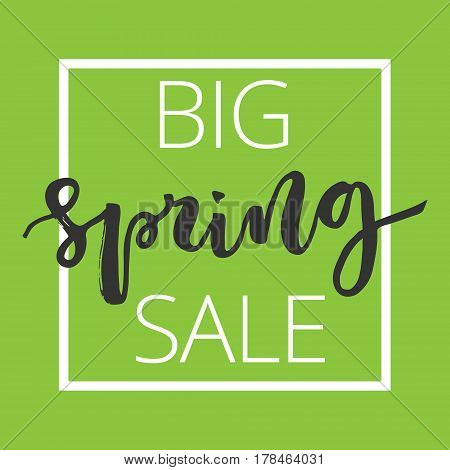 Big spring sale hand written inscription with white square frame on green background