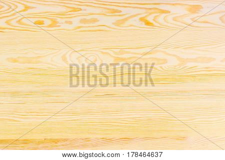 Background of the light-colored wooden surface made of the several pine planks