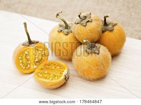 Solanum stramonifolium or Hairy-fruited eggplant on wooden.