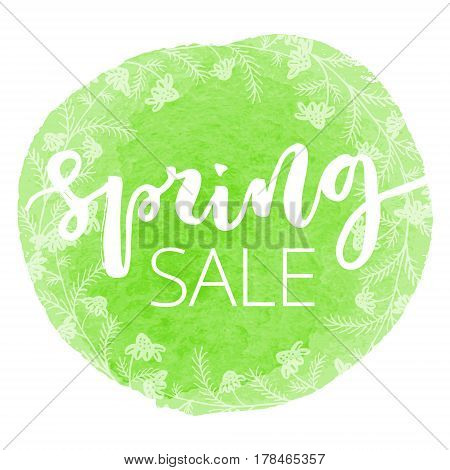 Spring sale white hand written inscription with floral wreath on green round watercolour banner background