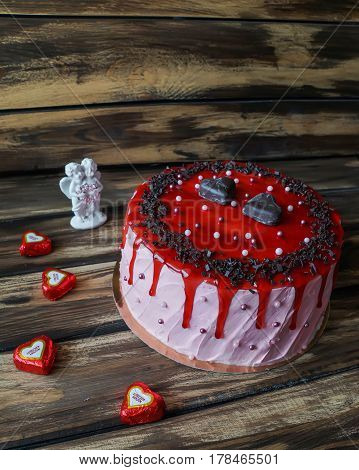 Delicious cake with chocolate chip, two candies like heart and strawberry jam decoration