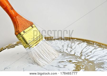 Paint Brush With A Wooden Handle In White Paint. Paint Tools In The Work. Repair And Finishing Works