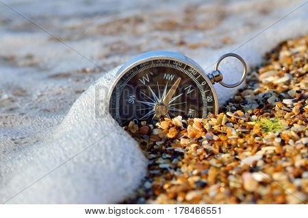 Nautical Compass In The Sand On The Seashore. Marine Navigation.