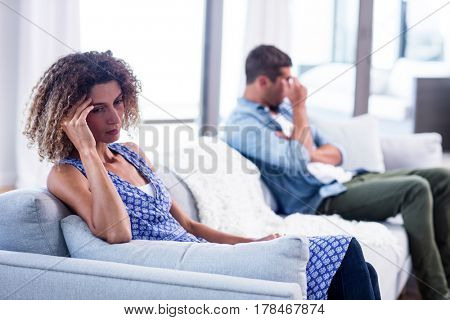 Upset young couple ignoring each other at home