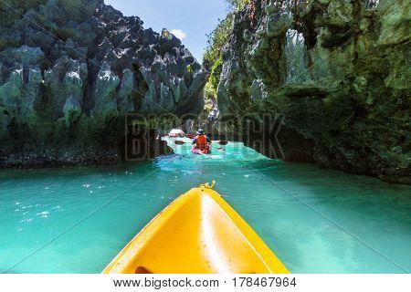 Kayak in the island lagoon between mountains. Kayaking journey in El Nido, Palawan, Philippines.