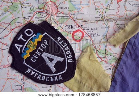 .Chevron of Ukraine army.Back-Map of Ukraine  with location of Balakleya .Place of arsenal explosion at 23 march. 138 kT. of TNT power.March 23 ,2017 in Kiev, Ukraine