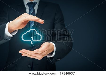Cloud computing security concept - connect devices to cloud. Businessman or information technologist with cloud computing icon and protective gesture.