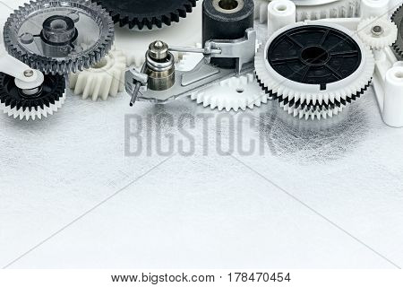 Industrial Metal Background With Plastic Black And White Cogwheels
