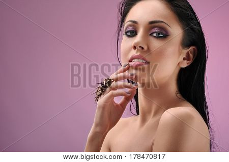 Hot woman. Gorgeous young brunette woman posing confidently on pink background copyspace beauty sensuality femininity cosmetics passion salon fashionable style concept
