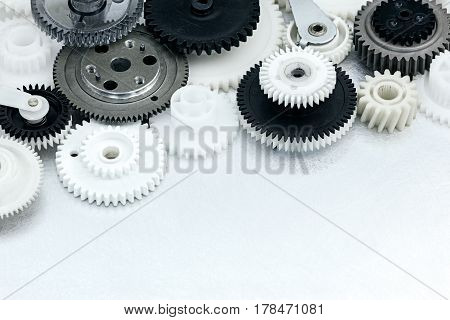 Plastic Gears On Scratched Industrial Metal Background
