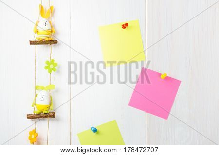 Egg Decoration Happy Easter Bunny On White Wooden Background With Yellow And Pink Sticker.