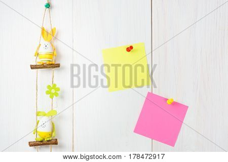 Egg Decoration Easter Bunny On White Wooden Background With Yellow And Pink Sticker.