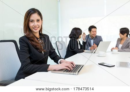 Group of business people meeting in office room