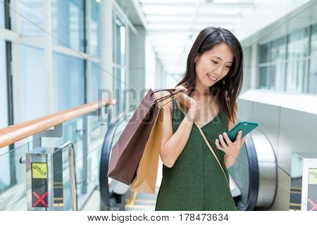 Woman carry with shopping bag and using cellphone
