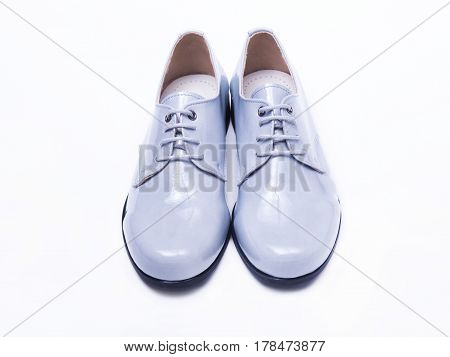 Gray lacquer shoes for a boy on an isolated background