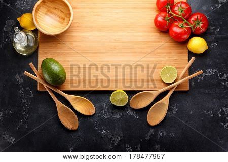 Wooden Dishes (board, Spoones, Bowl ) Fruits And Vegetables Are Ready For Cooking Dark Stone Backgro