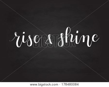 Rise and shine vector calligraphy hand-drawn lettering chalk inscription on blackboard