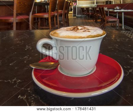 Capuccino with foam in a restaurant setting