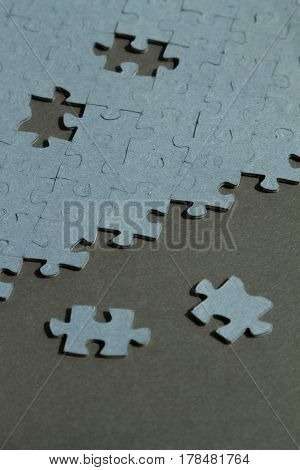 Jigsaw Puzzle background with two pieces out of it with copy space