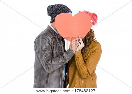 Happy young couple holding heart on white background