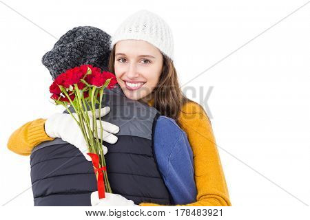 Happy couple hugging each other with flowers on white background