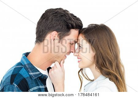 Couple standing head against head and holding chin on white background