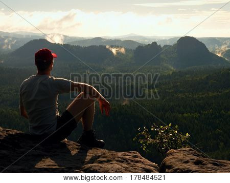 Man Tourist Sit On Rock Empire And Enjoy Freedom. Dreamy Landscape