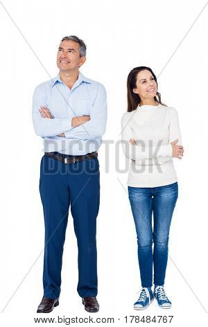 Relaxed couple looking at different ways on white background