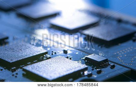 Close up Image of the Electronic Circuit Board with Processors in Bright Light. Computer Technology Concept Background