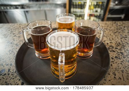 Four glasses of beer in a bar