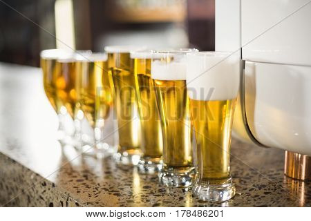 Lined up beers on table in bar