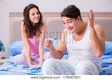 Happy couple finding out about pregnancy test results
