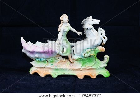 horses, woman and sea shell (four inches tall, seven wide)
