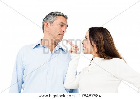 Angry couple arguing on white background