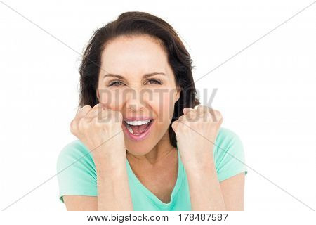 Pretty woman celebrating victory against white background