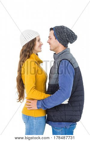 Happy couple embracing and looking each other on white background