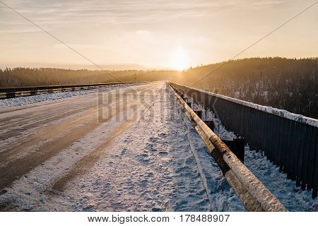 Evening winter road. The beautiful evening sunset.