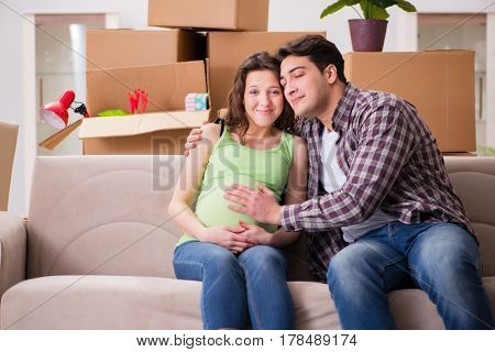 Young couple of man and pregnant wife expecting baby