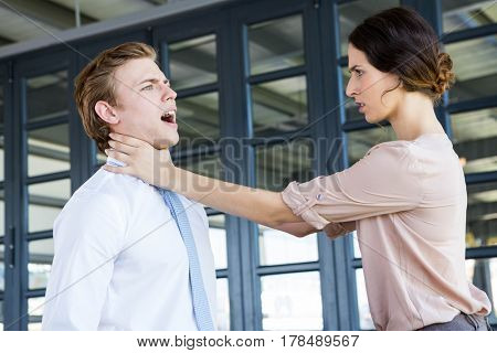 Two young business colleagues having an argument in office